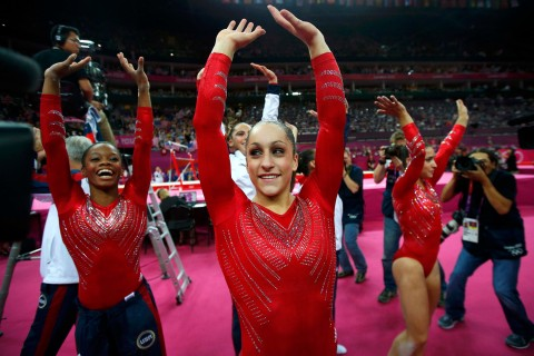 Jordyn Wieber of the U.S. and team mate Gabrielle Douglas celebrate after the women's gymnastics team final in the North Greenwich Arena at the London 2012 Olympic Games