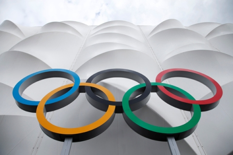 The Olympic rings are displayed outside the basketball arena in the Olympic Park before the start of  the 2012 Summer Olympics, Sunday, July 15, 2012, in London.