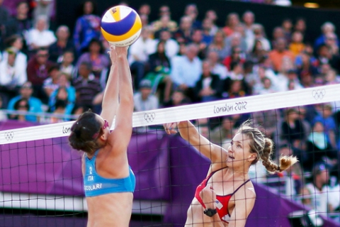 Jennings of the U.S. spikes the ball against Italy's Cicolari during their women's quarterfinals beach volleyball match at Horse Guards Parade during the London 2012 Olympic Games