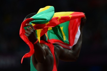 image: Grenada's Kirani James celebrates after winning the men's 400m final at the athletics event of the London 2012 Olympic Games in London, Aug. 6, 2012.