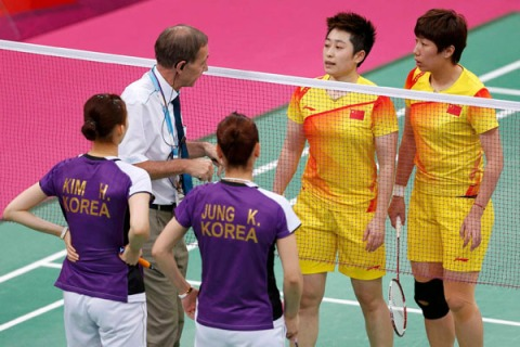 Combination photo shows officials speaking to players from China  and South Korea, and players from South Korea and Indonesia during their women's doubles group stage badminton matches during the London 2012 Olympic Games
