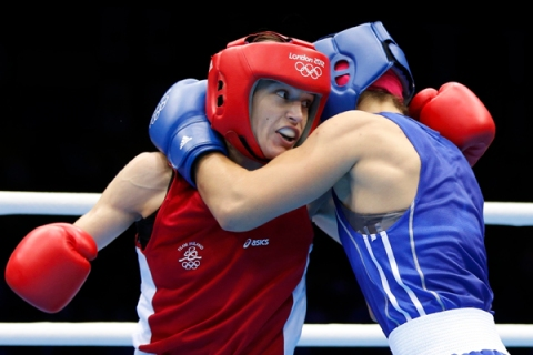 Ireland's Katie Taylor fights Russia's Sofya Ochigava during their Women's Light (60kg) gold medal boxing match at the London Olympic Games