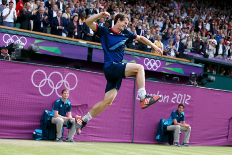 Britain's Murray celebrates after defeating Switzerland's Federer in the men's singles tennis gold medal match at the All England Lawn Tennis Club during the London 2012 Olympic Games