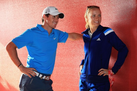 Rory McIlroy of Northern Ireland talks to his fiance Caroline Wozniacki of Denmark, after coming joint second after the final round of the Abu Dhabi HSBC Golf Championship at Abu Dhabi Golf Club on January 19, 2014 in Abu Dhabi, United Arab Emirates.